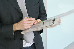 Good news. Man reading a newspaper with positive chart graph royalty free stock photos