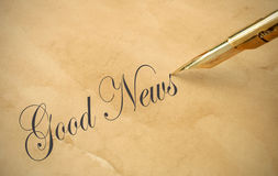 Good news. The words good news written with a vintage fountain pen Stock Image