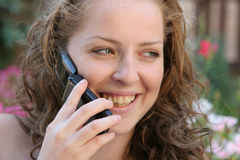 Good news. Young pretty women talking on phone Stock Images