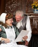 Good news. Vintage scene of a Victorian couple reading good news in a letter Stock Images