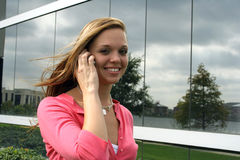 Good news. Young woman talking on a cell phone Royalty Free Stock Photography