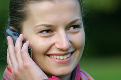 Good news. A headshot of an attractive woman talking on a phone Royalty Free Stock Image