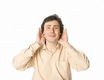 Good news. A man listening to something with a smile Royalty Free Stock Photography