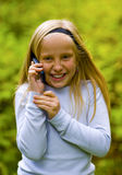 Good News. Received by a young girl on a cell phone Stock Photo