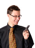 Good news. Businessman holding a communication device  isolated on white Royalty Free Stock Photos