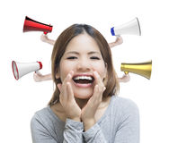Good news. Asian woman telling good news with megaphones on white background royalty free stock photo