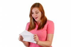 Good news. An attractive woman opens letter with good news inside Stock Photography