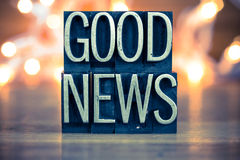 Good News Concept Metal Letterpress Type. The words GOOD NEWS written in vintage metal letterpress type on a soft backlit background Stock Photo