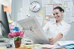 Good news on financial newspaper Stock Photo