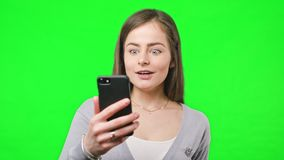 Good News on Her Phone stock footage