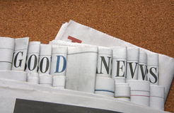 Good news on newspapers. Good news letters on newspapers Stock Images