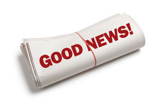 Good News. Newspaper roll with white background Royalty Free Stock Photography