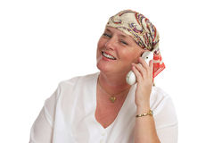 Good News By Phone. A woman, bald from medical treatment, receiving good news by telephone Stock Image