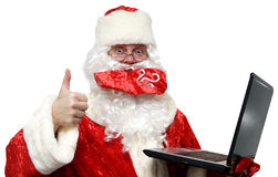 Good news from Santa Claus. Close-up of Santa Claus with laptop isolated on white Stock Photo