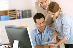 Good news on tablet screen for the business team royalty free stock photo