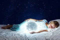Good night. Girl lying in bed with moon at hands Royalty Free Stock Photo