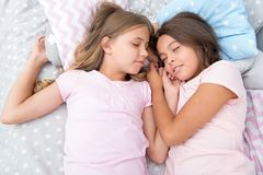 Good night and healthy sleep. little girls have a good night in bedroom. little girls have healthy sleep. time to relax.  royalty free stock photography