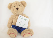 Good night message card and teddy bear. On background white Royalty Free Stock Photo