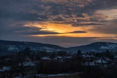 Good night !. Sun setting down behind clouds and mountains in winter Stock Images