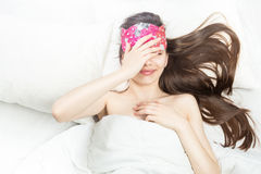 Good night sweet dreams. Beautiful long hair woman lying on a white bed. Sleepy morning! I do not want to wake up! Give a nap! Top view Stock Images