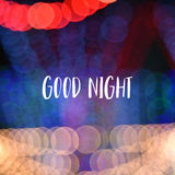 Good night text on colorful bokeh background.  Royalty Free Stock Images