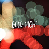 Good night text on colorful bokeh background.  Stock Photos