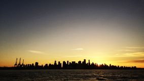 Good night Vancouver. Sunset panoramic of Vancouver British Columbia, Canada. The city thrown into a silhouetted relief, a cityscape against the fading light of Royalty Free Stock Photos