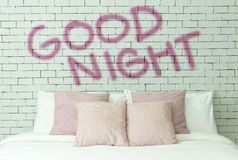 Good night word on white bricks wall background Stock Images