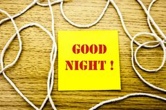 Good Night word on yellow sticky note in wooden background. Bussines concept. Good Night. word on yellow sticky note in wooden background. Bussines concept Stock Image