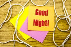 Good Night word on yellow sticky note in wooden background. Bussines concept. Good Night. word on yellow sticky note in wooden background. Bussines concept Stock Photos