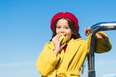 Good nutrition essential good health. Kid girl eat apple fruit. Healthy diet. Snack while walk. Kids health and. Nutrition. Healthy snacking benefits. Snack stock photography