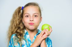 Good nutrition is essential to good health. Kid girl eat green apple fruit. Nutritional content of apple. Vitamin. Nutrition concept. Reasons eat apple every royalty free stock photo