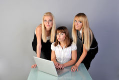 Good office. Three womens in office with laptop Royalty Free Stock Photo