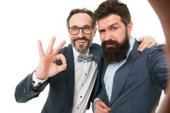 With good old friend. Men successful entrepreneurs on white background. Join our business team. Business people concept. Men bearded stylish guys wear formal stock photos