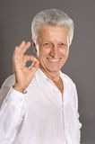 Good old man showing ok Stock Photography