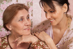 A good older woman with her adult daughter Stock Photos