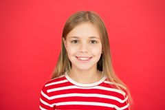 Good parenting. Child care. family and love. childrens day. happy little girl on red background. small girl child royalty free stock image