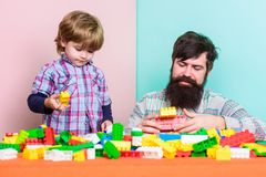 Good parenting concept. small boy with dad playing together. father and son play game. happy family leisure. love. child. Development. building with color stock images