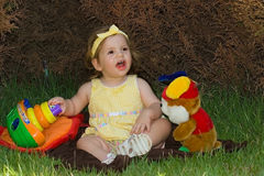 It is good in the park. Little girl playing on the grass Royalty Free Stock Photo