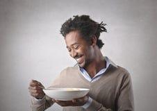 A good pasta. A black man savoring a good pasta Royalty Free Stock Image