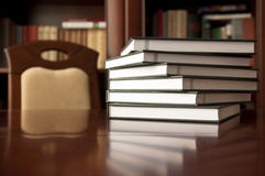 Good place for reading. Bookstack on a wooden table Royalty Free Stock Photos