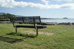 Park Bench Along The Ocean In Maui Stock Images