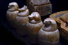 Ancient bureal urns or vessels. Good quality photo of ancient traditional bureal vessels. Photo shows four different urns with animalistic shapes - you may see royalty free stock images