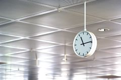 Large round white clock. Good quality photo of an industrial or street clock. You may see quite simple and modern crystal white clock made of plastic and metal Royalty Free Stock Photography