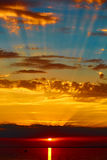 Good red sunset over darken sea. The good red sunset over darken sea Stock Image