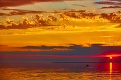 Good red sunset over darken sea. The good red sunset over darken sea Stock Images
