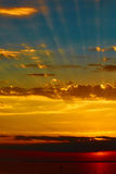 Good red sunset over darken sea Stock Photos