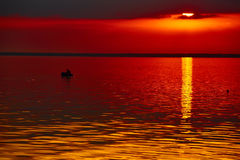 Good red sunset over darken sea Royalty Free Stock Image