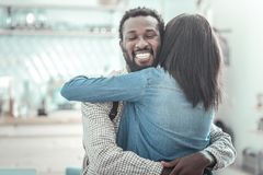 Joyful positive man hugging his friend Royalty Free Stock Photo