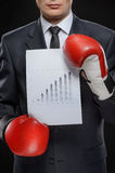 Good results. Confident businessman in red boxing gloves holding Royalty Free Stock Photo